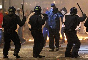 Riot police confronting by rioters in 2011 riots in England